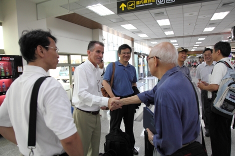 Jim meeting the other presenters at the airport in Taipei
