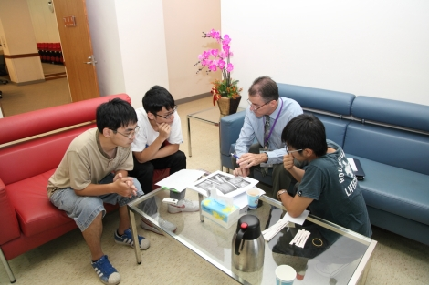 Jim meeting with university students to answer questions from his presentation