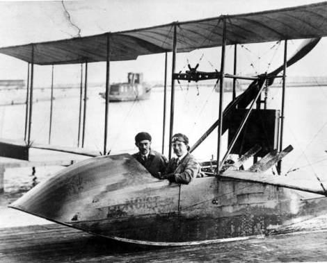 "Men sitting in the flying boat ""Benoist"" in Saint Petersburg, Florida (via Florida Memory)"