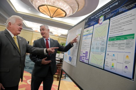 Rich Biter, left, FDOT Assistant Secretary, Intermodal Systems Development, talks with Brad Swanson, FDOT freight logistics and passenger operations administrator, during the 2nd Annual Data Symposium in Championsgate, Fla., Tuesday, Aug. 18, 2015. More than 400 attendees from across the nation gathered at the symposium, sponsored by the Florida Department of Transportation to share ways to use big data to improve transportation safety and efficiency. (AP Photo/Phelan M. Ebenhack)